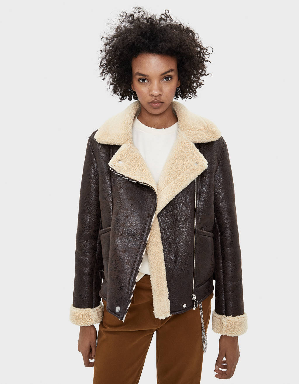 Double-faced jacket with faux shearling