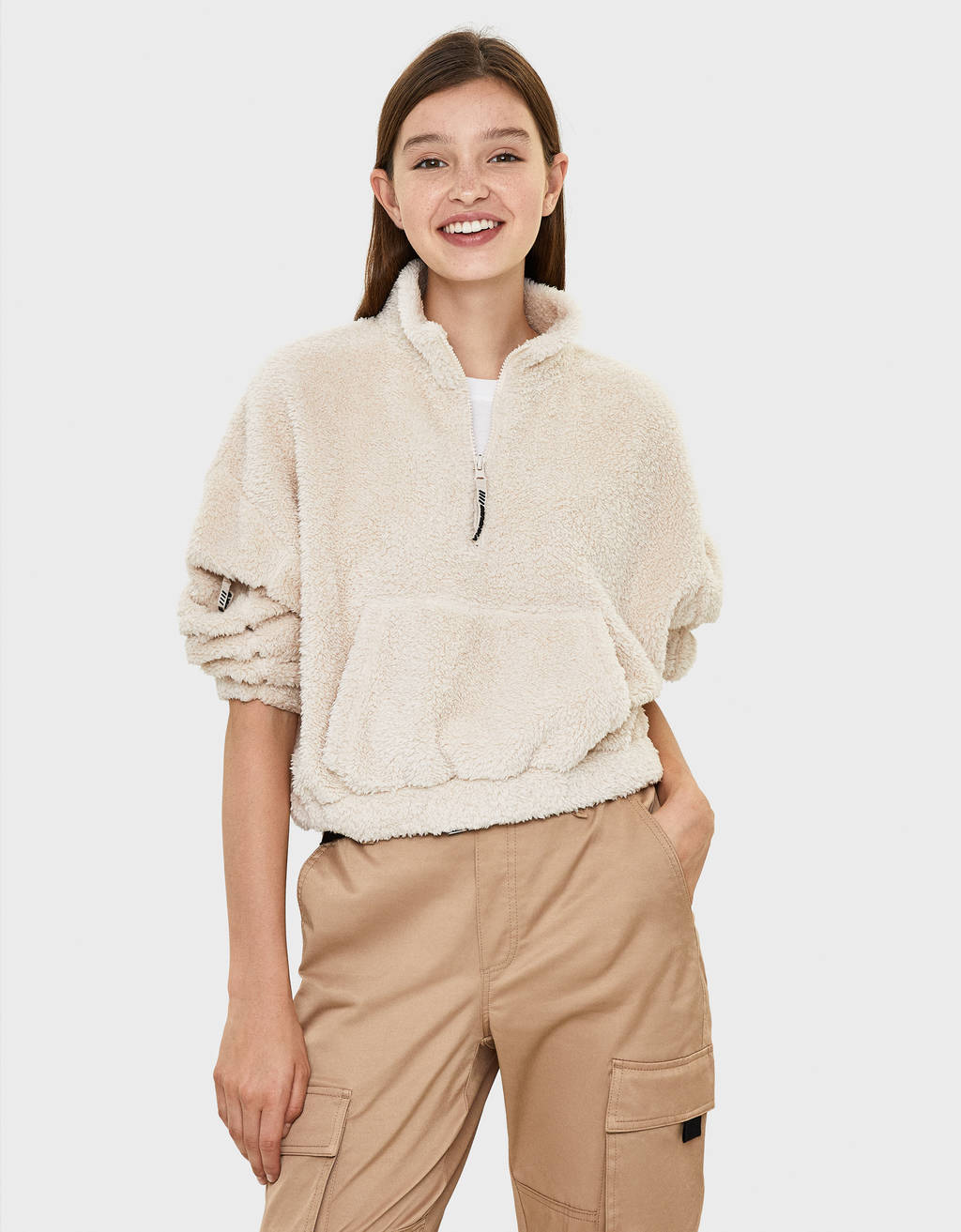 Faux shearling pouch pocket sweater