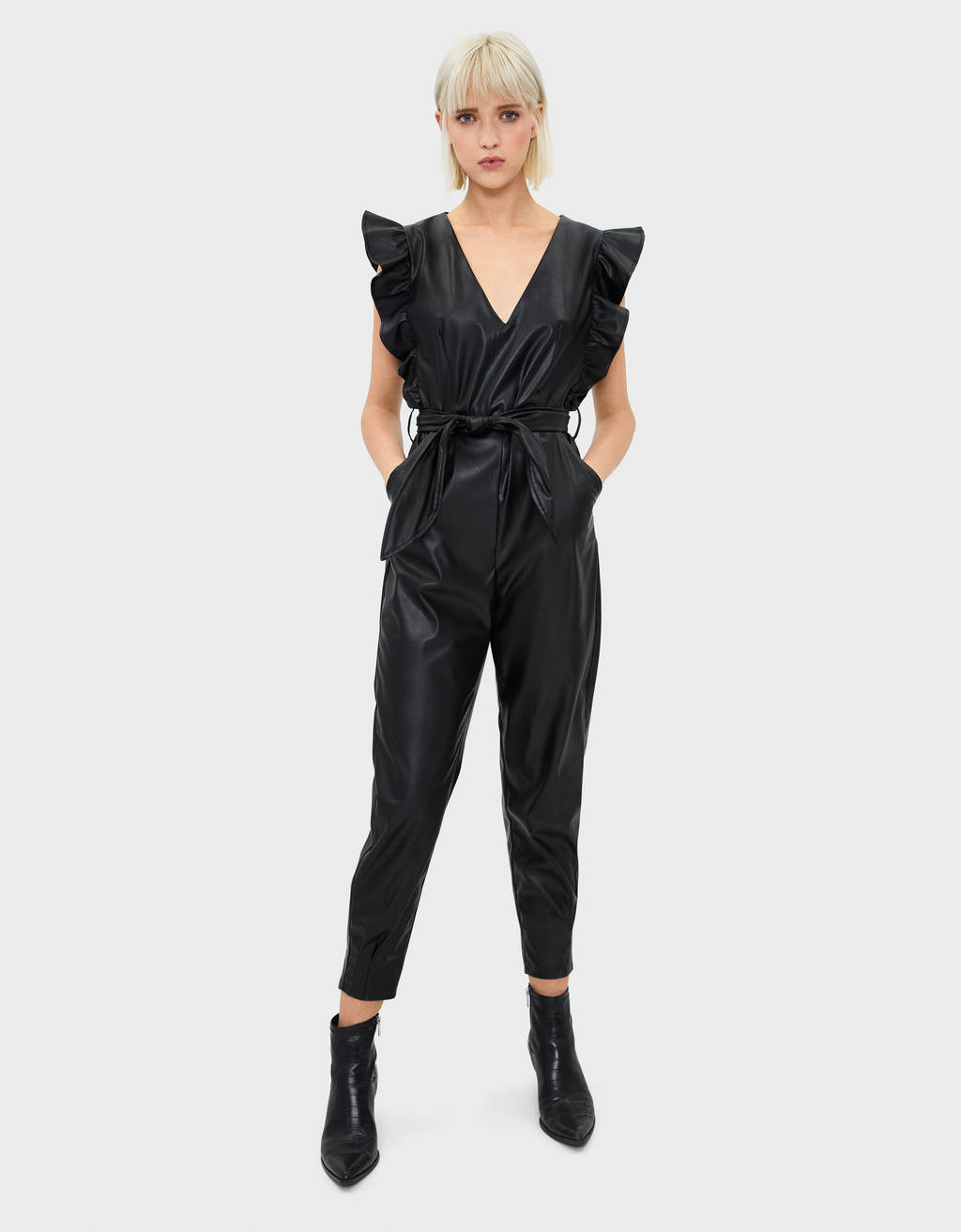 Faux leather jumpsuit with ruffle trims