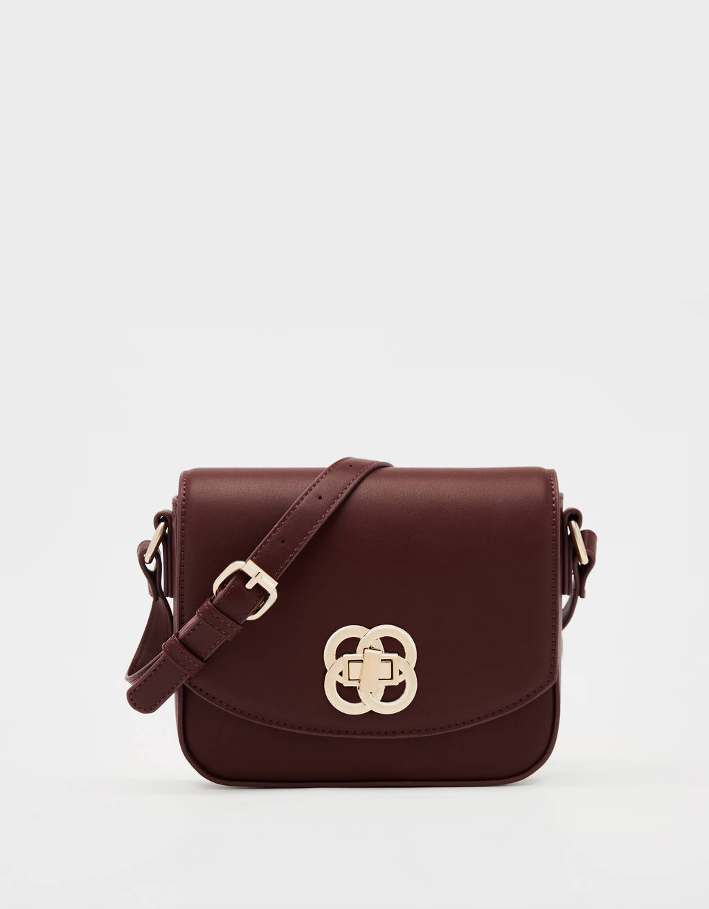 Crossbody bag with plaque