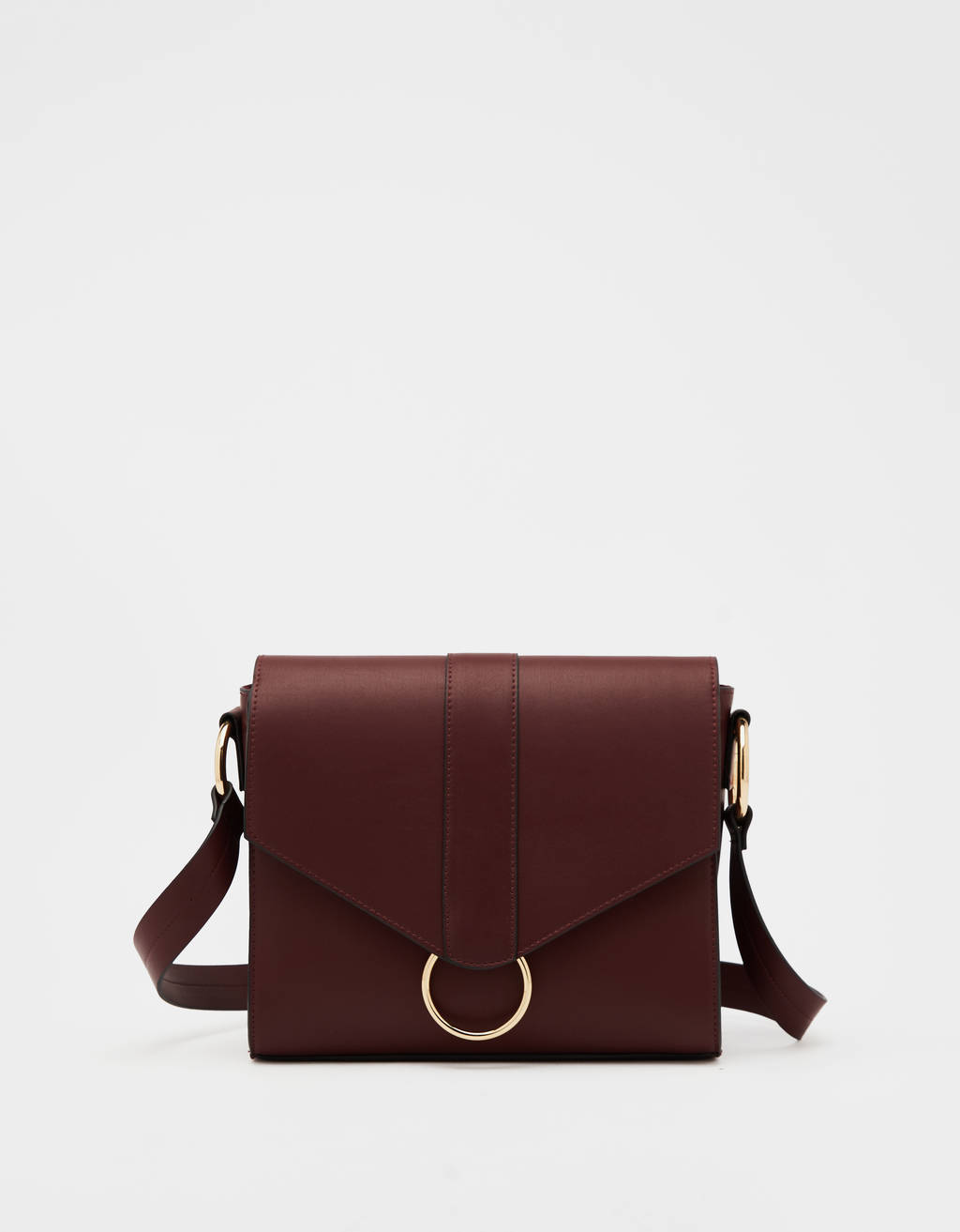 Crossbody bag with foldover flap and ring