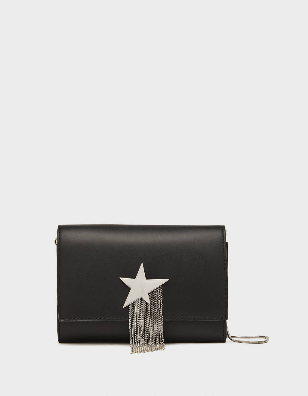 Bag with metallic star and fringing