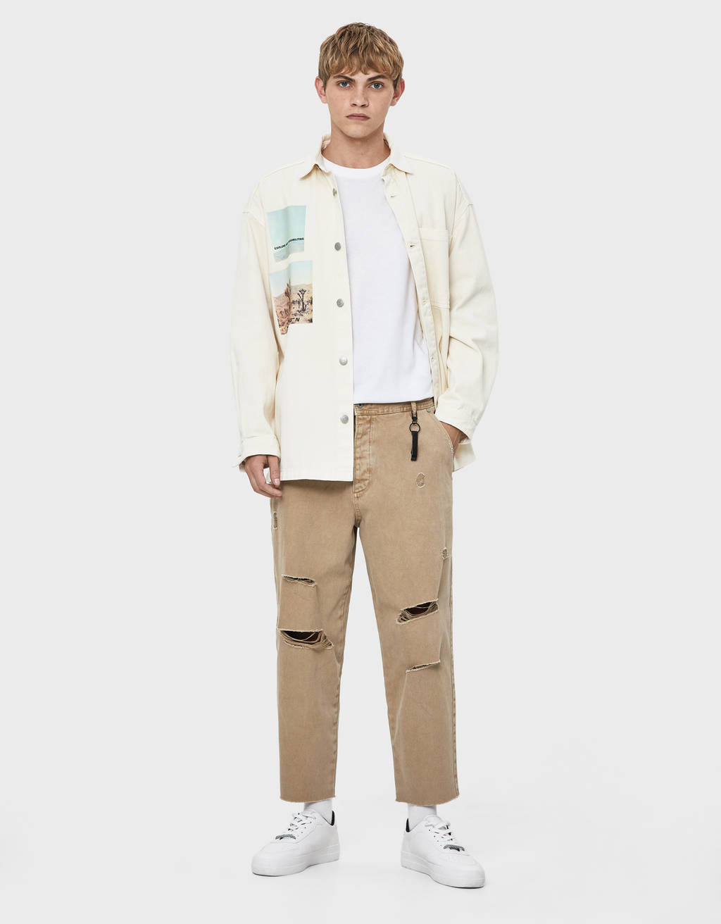 Loose fit trousers with rips