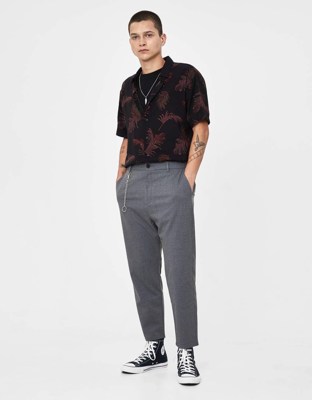 Loose fit trousers with chain