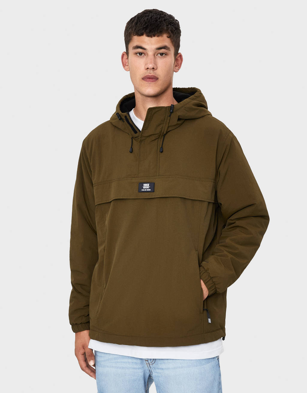 Puffer jacket with pouch pocket