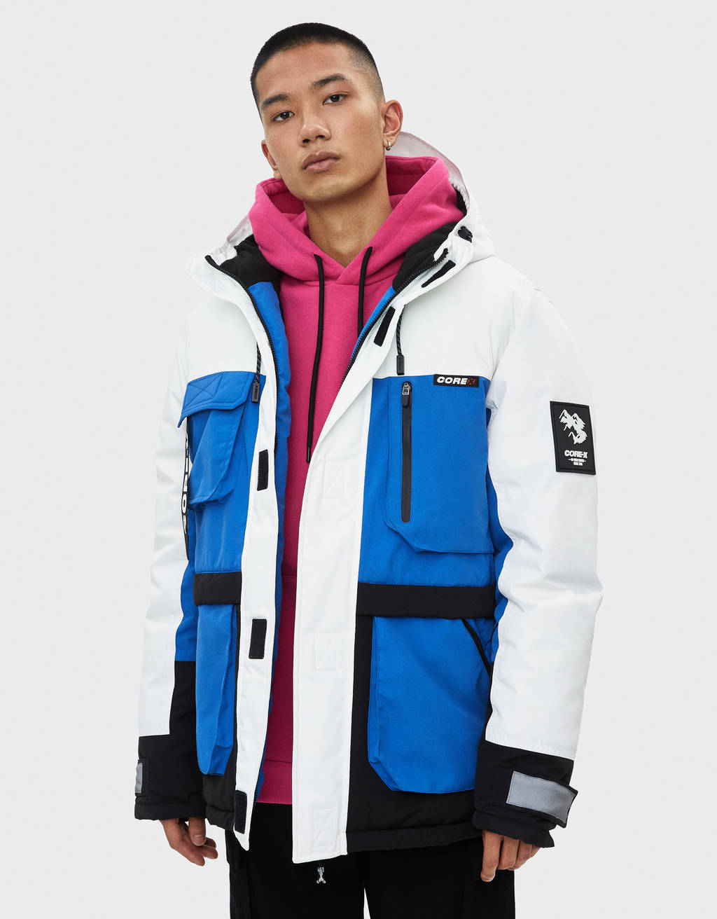 Technical parka with multiple pockets