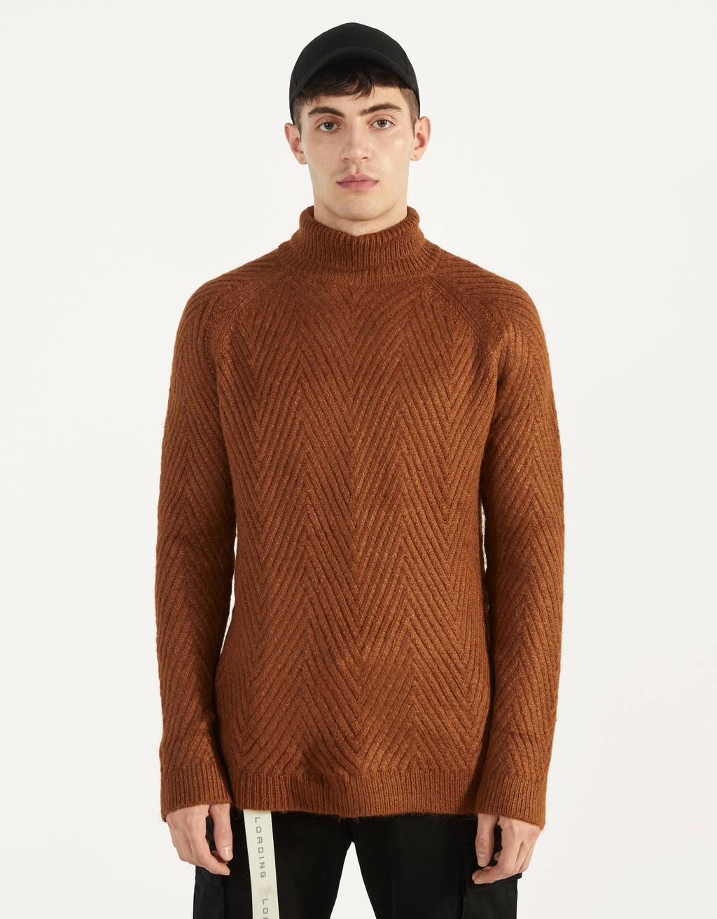 Sweater trançada de gola alta