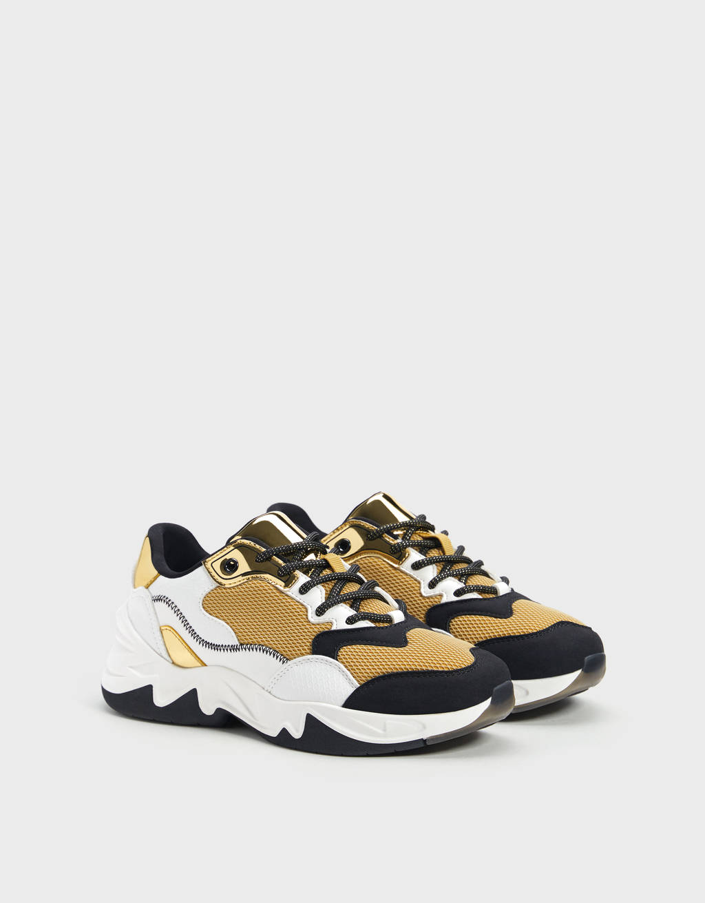 Trainers with contrast gold details