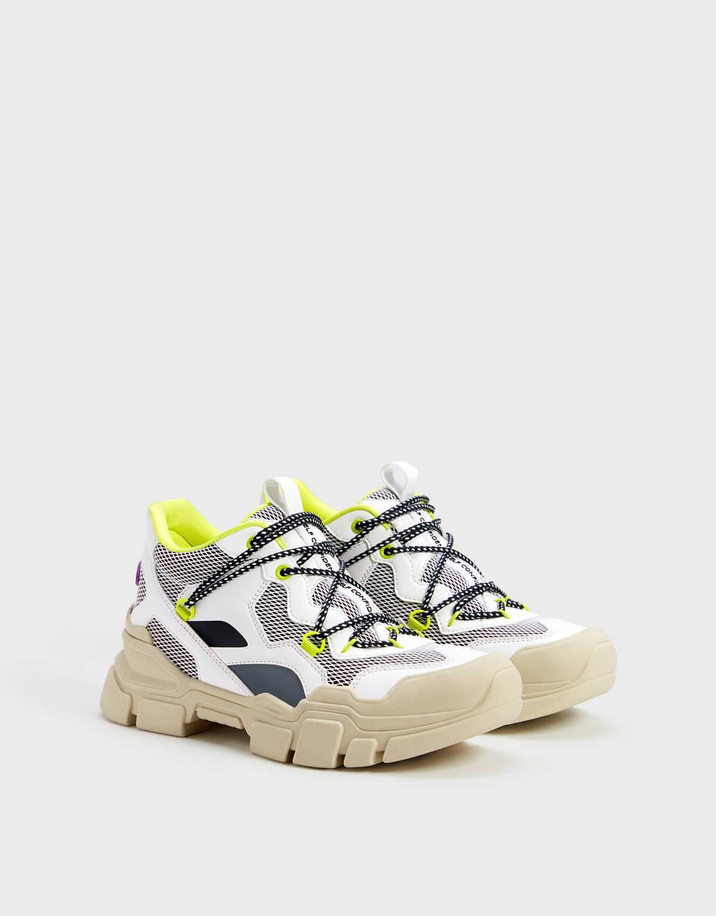 Sneakers stile trekking con dettagli fosforescenti