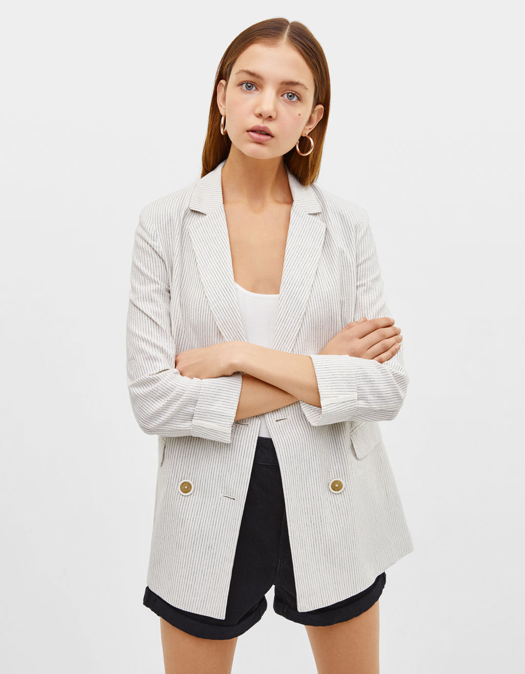 Linen blazer with rolled-up sleeves