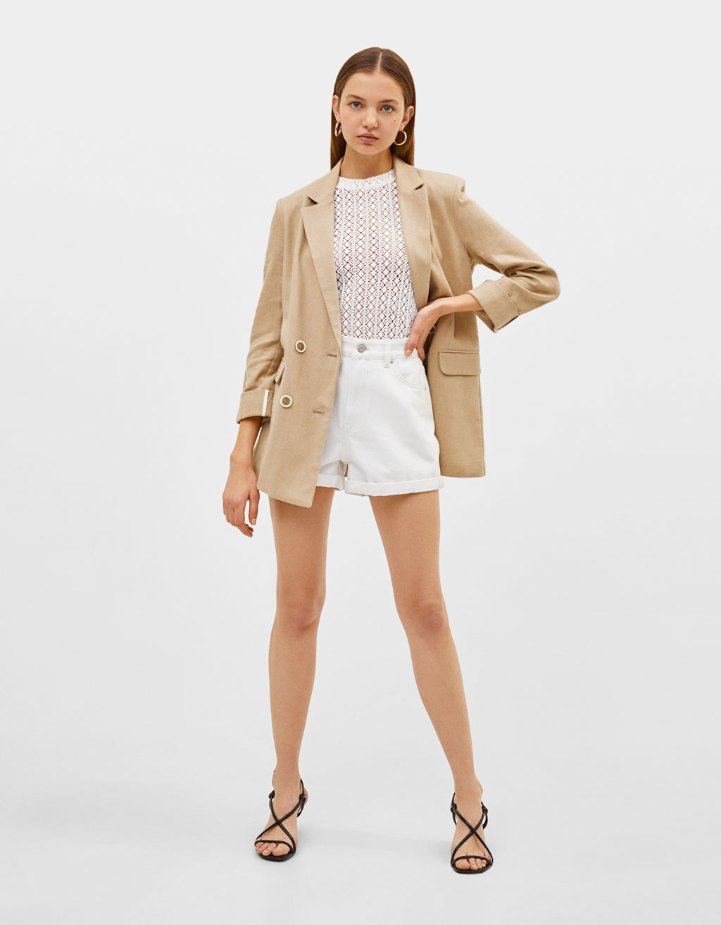 Rustic blazer with rolled-up sleeves