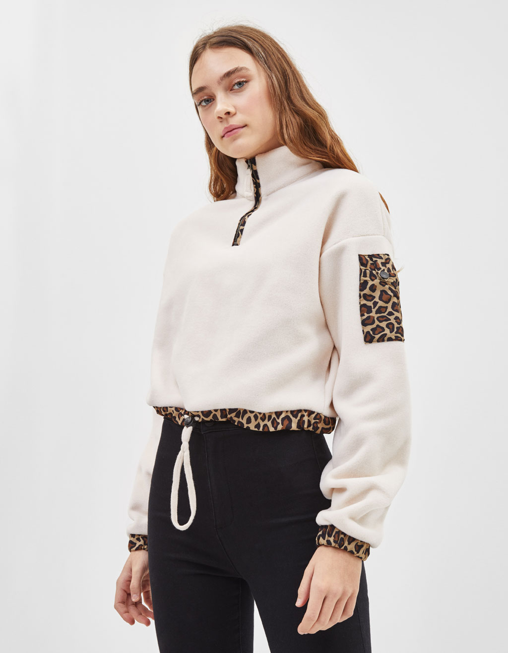 Fleece sweater with leopard print trims