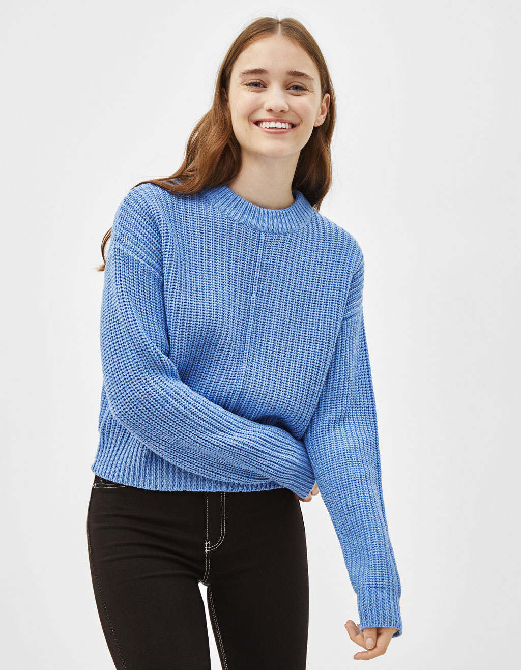 Knitted sweater with marked seams