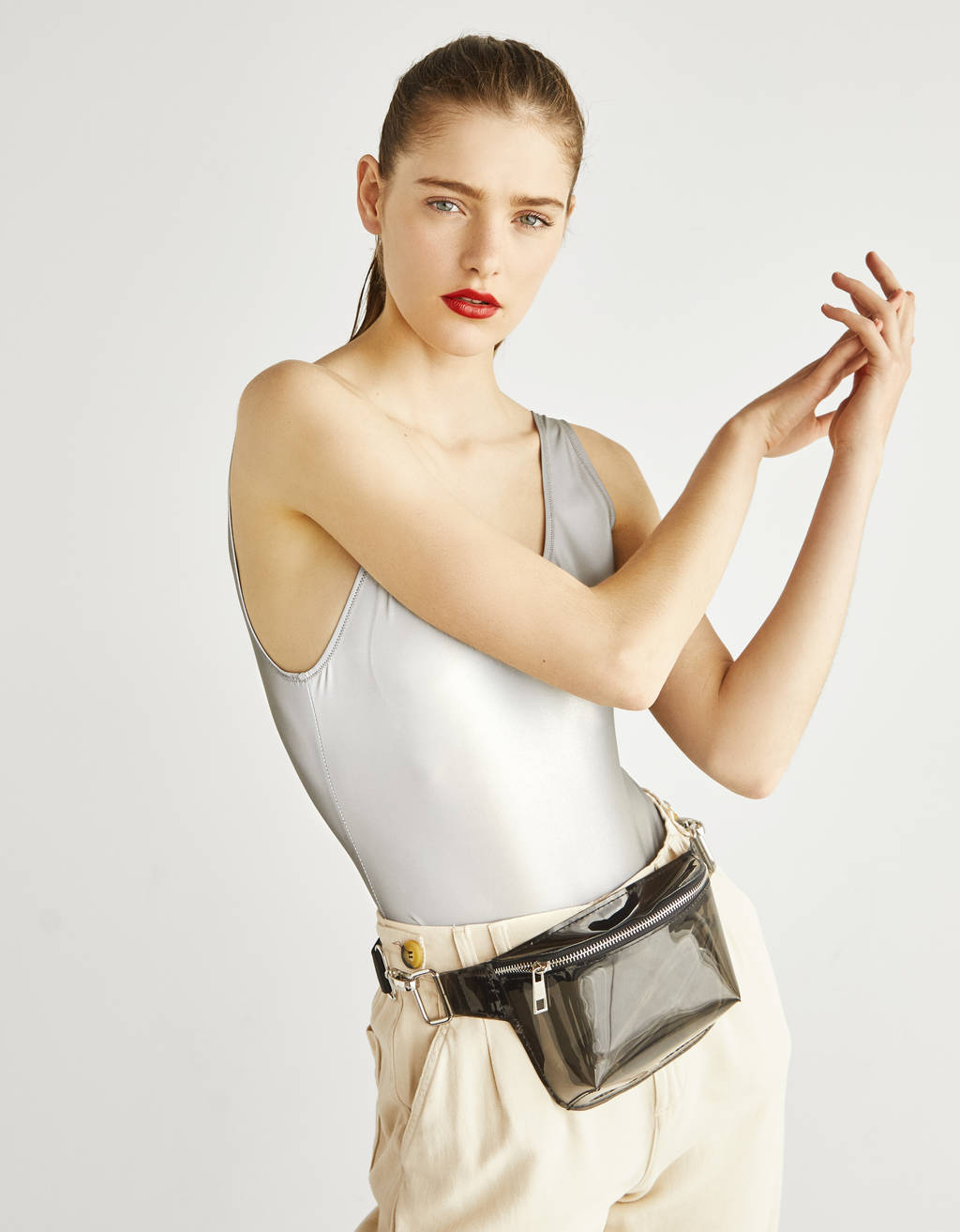 Reflective bodysuit with straps