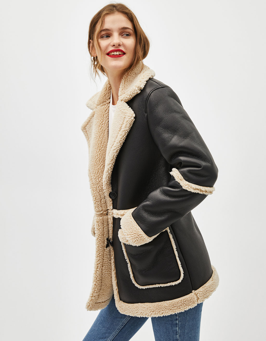 Coat with faux shearling lining