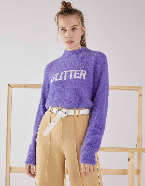 Fuzzy sweater with slogan