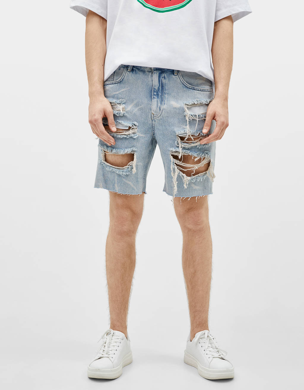Slim fit denim Bermuda shorts with rips