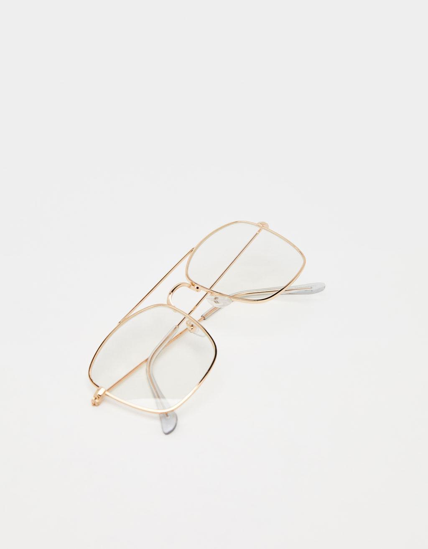 Gafas transparentes con montura metálica