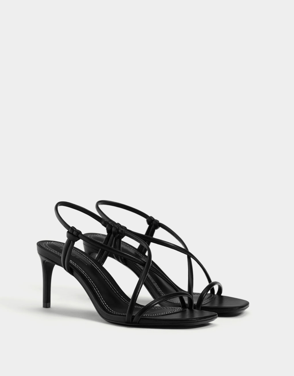 Heeled sandals with tubular straps