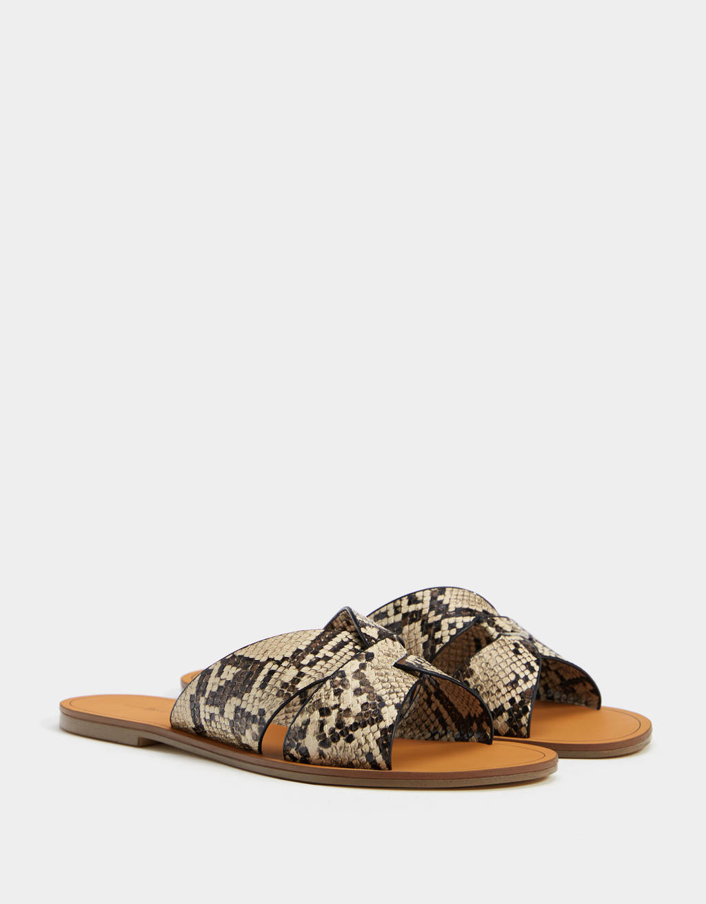 Animal print crossed vamp sandals