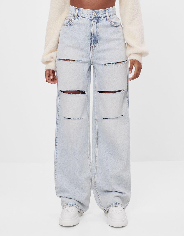Jeans anni 90 flare con strappi