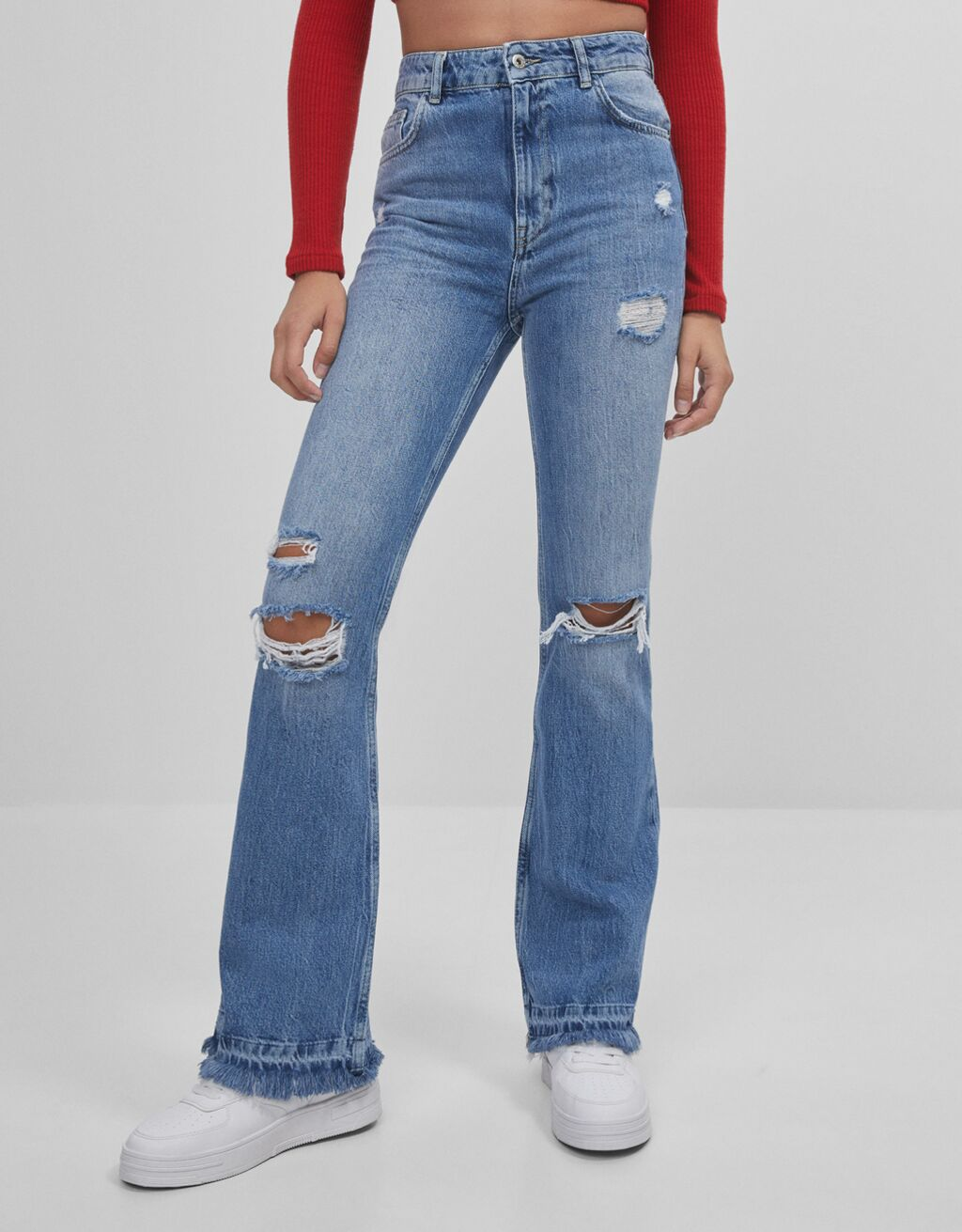 Flared jeans with rips