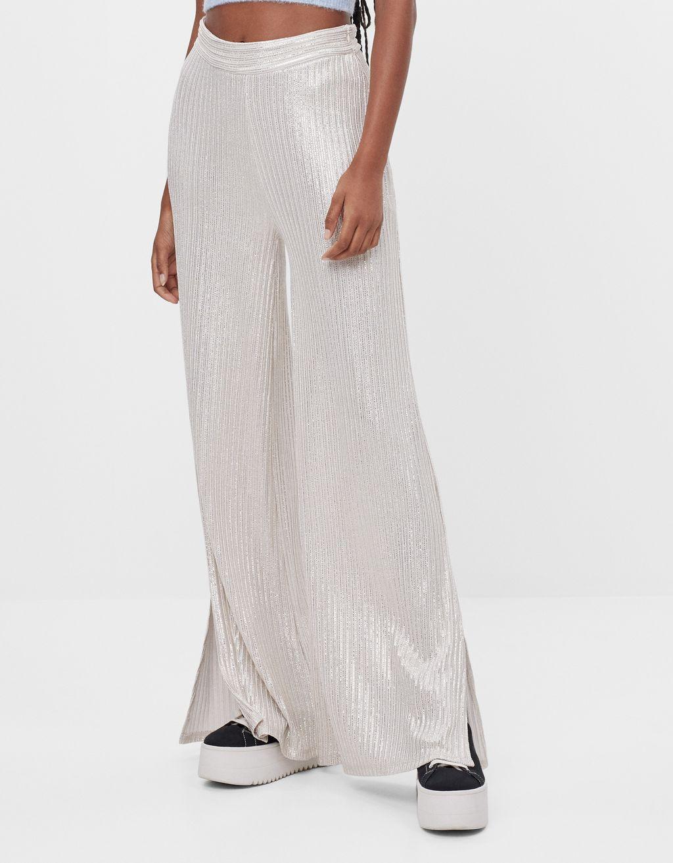Pantaloni flare fit con filo metallizzato