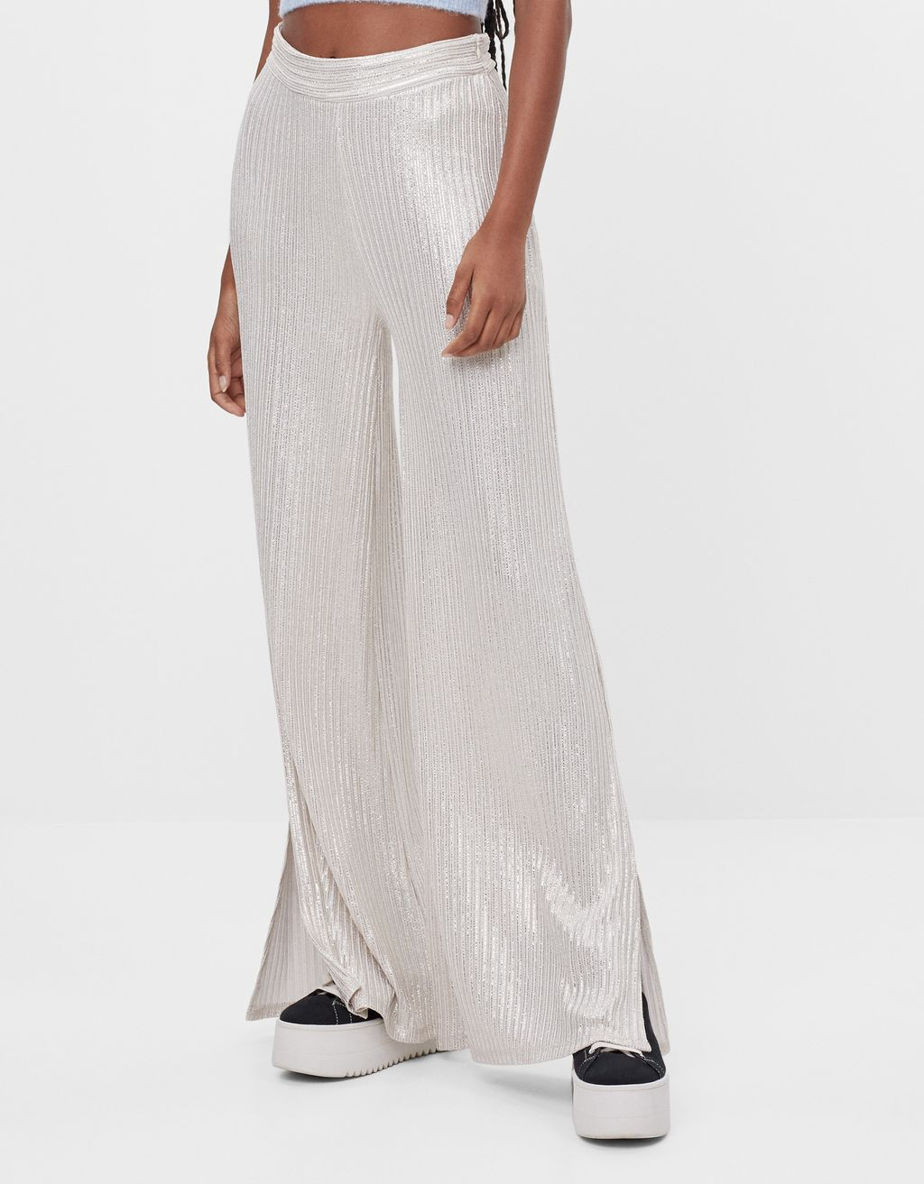 Flared trousers with metallic thread