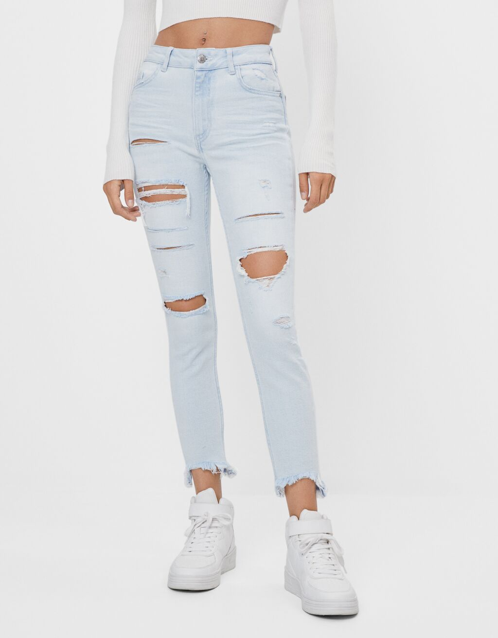 Low-rise ripped skinny jeans