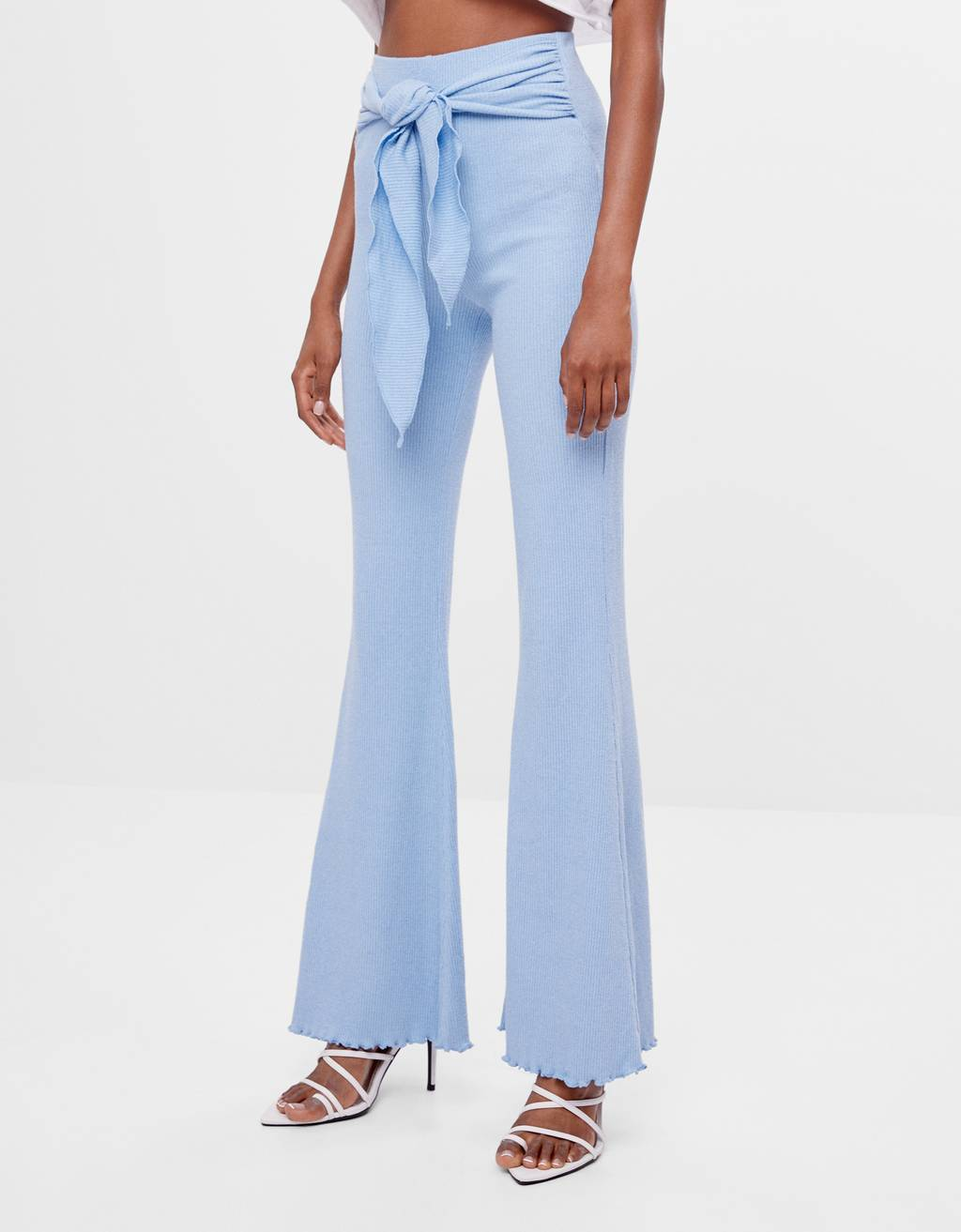Flared trousers with bow