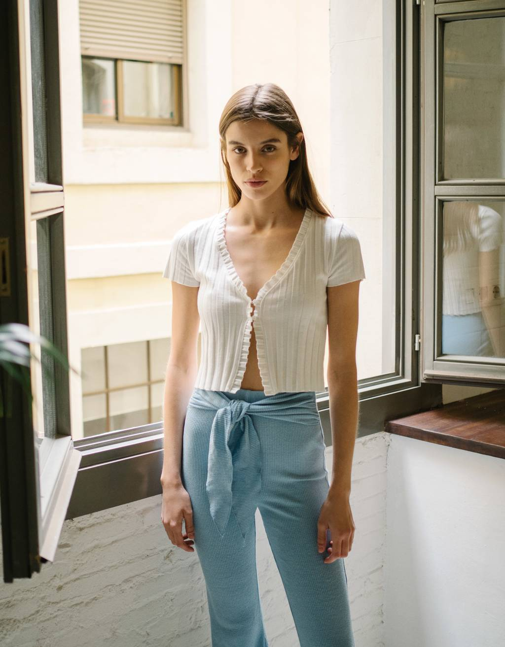 Flared trousers with lace-up front
