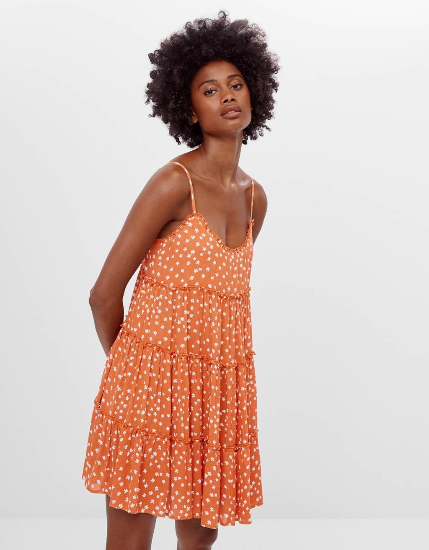 Obleka z naramnicami in s cvetličnim potiskom