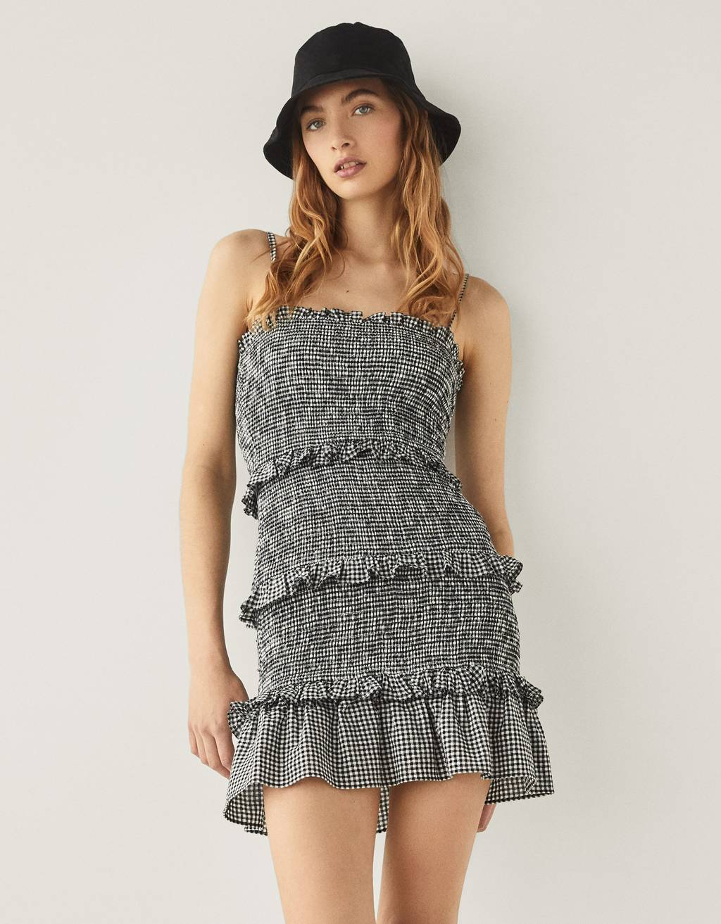 Short dress with ruffles and a gingham check print