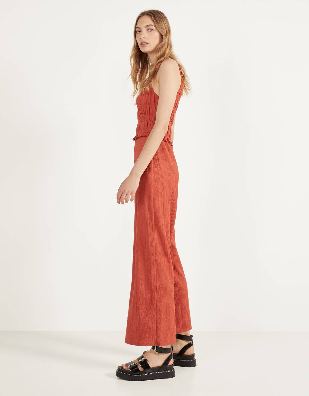 Jumpsuit featuring a shirred elastic neckline