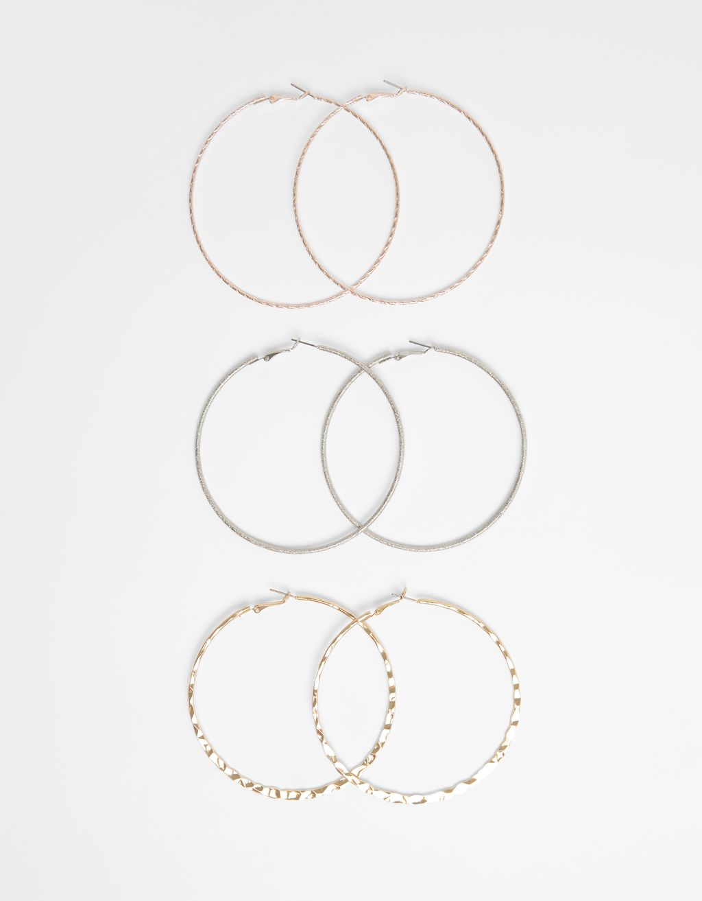 Set of mirrored hoop earrings