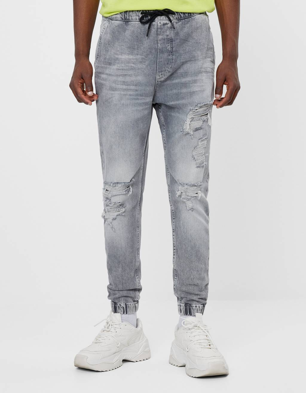 Jeans jogger con strappi