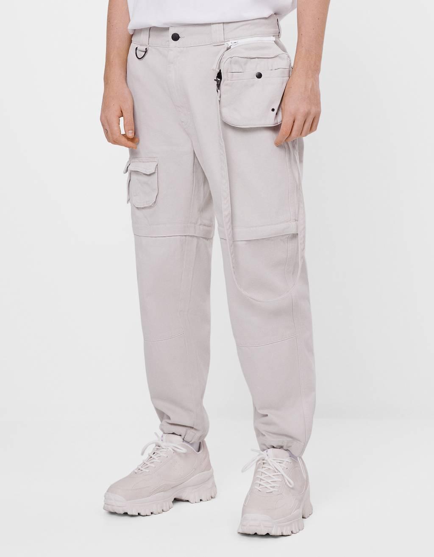 Denim trousers with detachable details