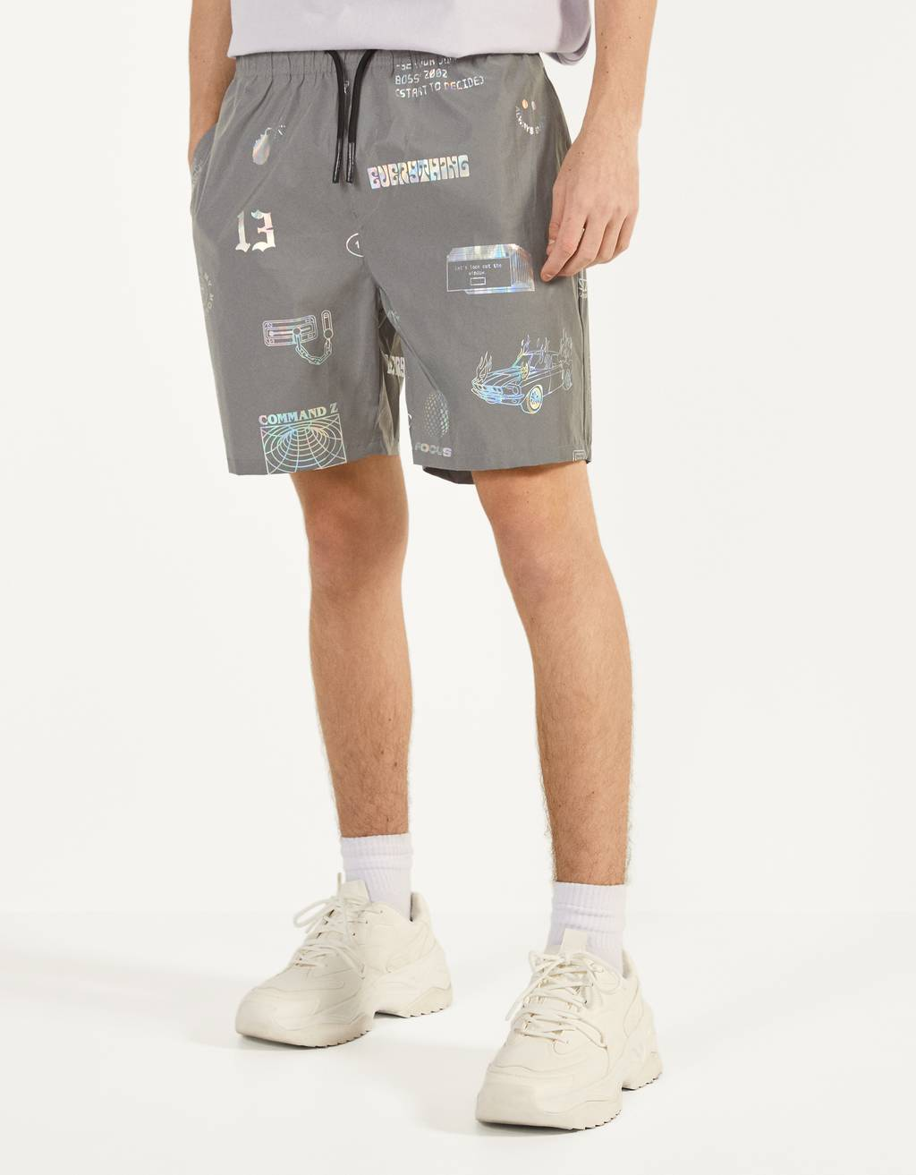Bermuda shorts with reflective print