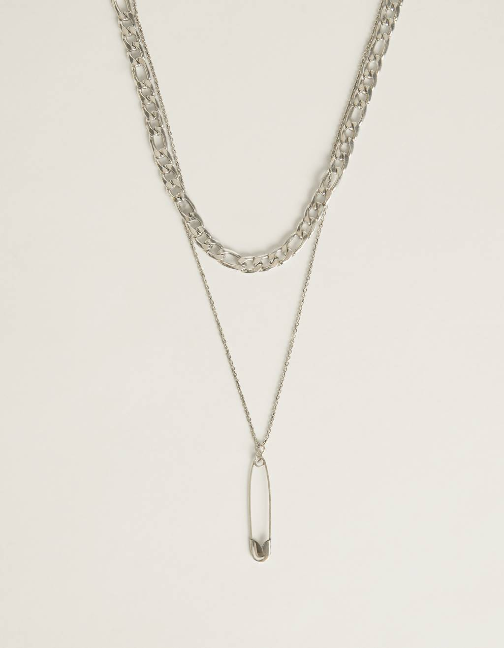 Necklace with a silver-coloured safety pin pendant