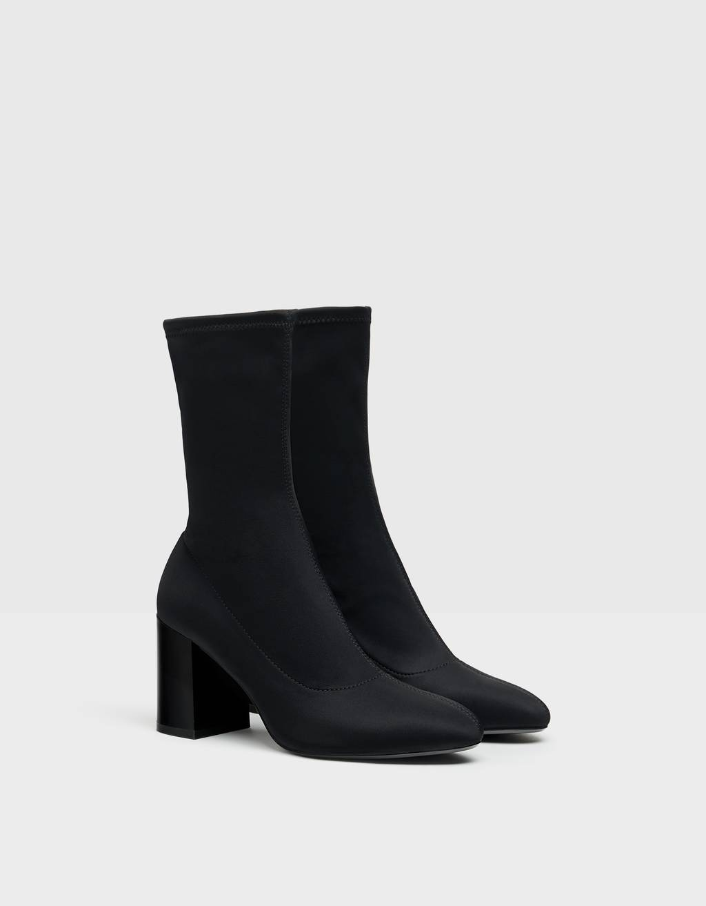Stretchy high-heel ankle boots.