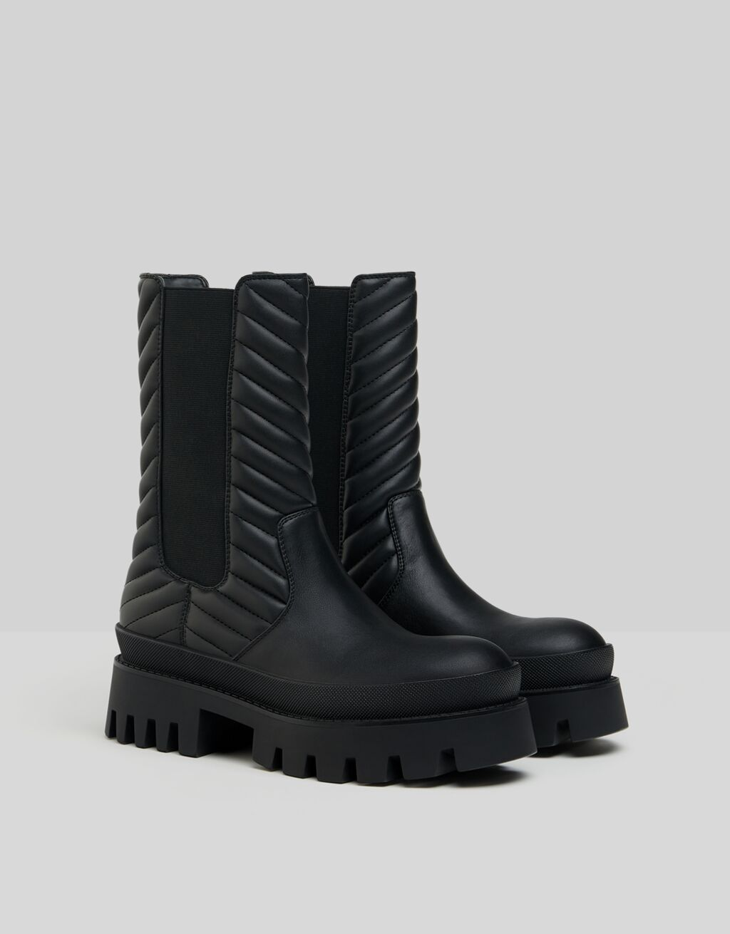 Quilted platform ankle boots with stretch detail
