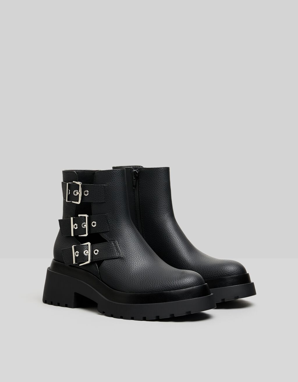 Flat ankle boots featuring cut-out detail with buckles