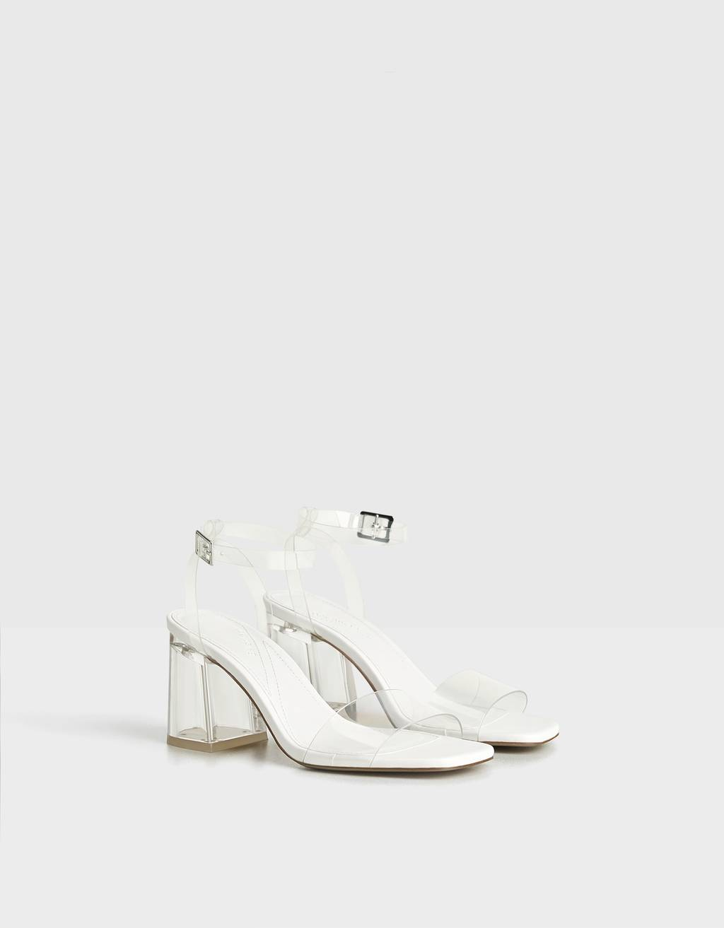 Methacrylate heeled sandals with vinyl detail.