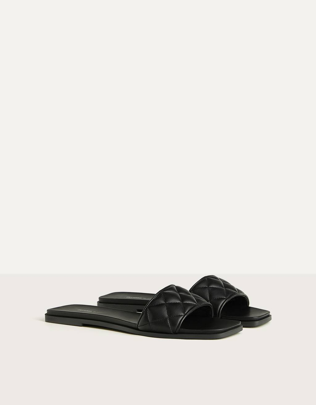 Flat quilted sandal