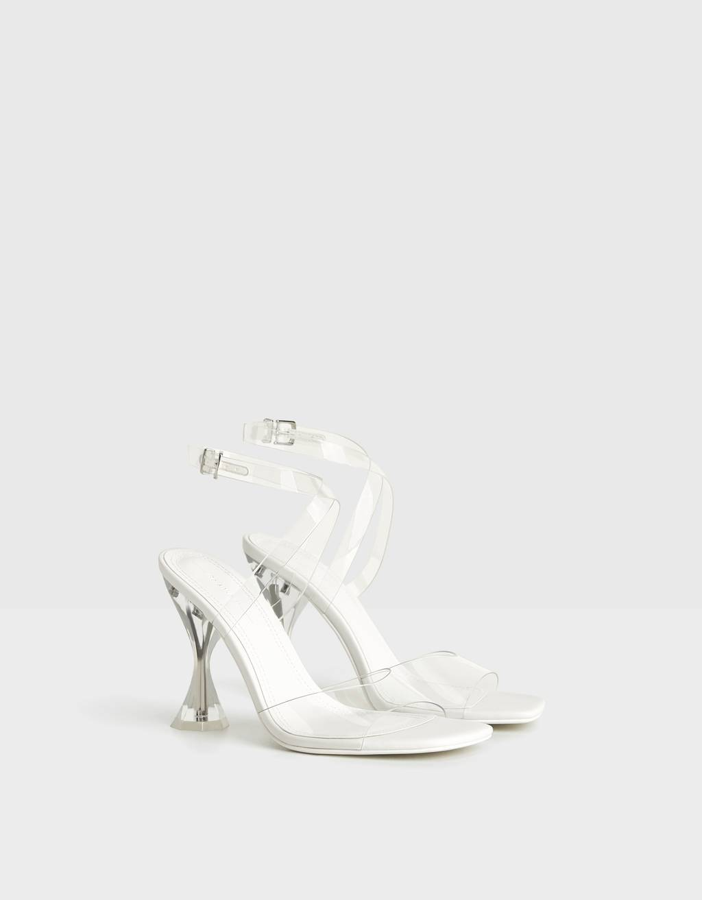 High-heel sandals with vinyl straps and methacrylate heels.
