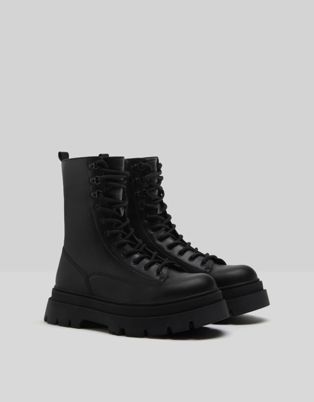 Lace-up boots with track soles - Shoes