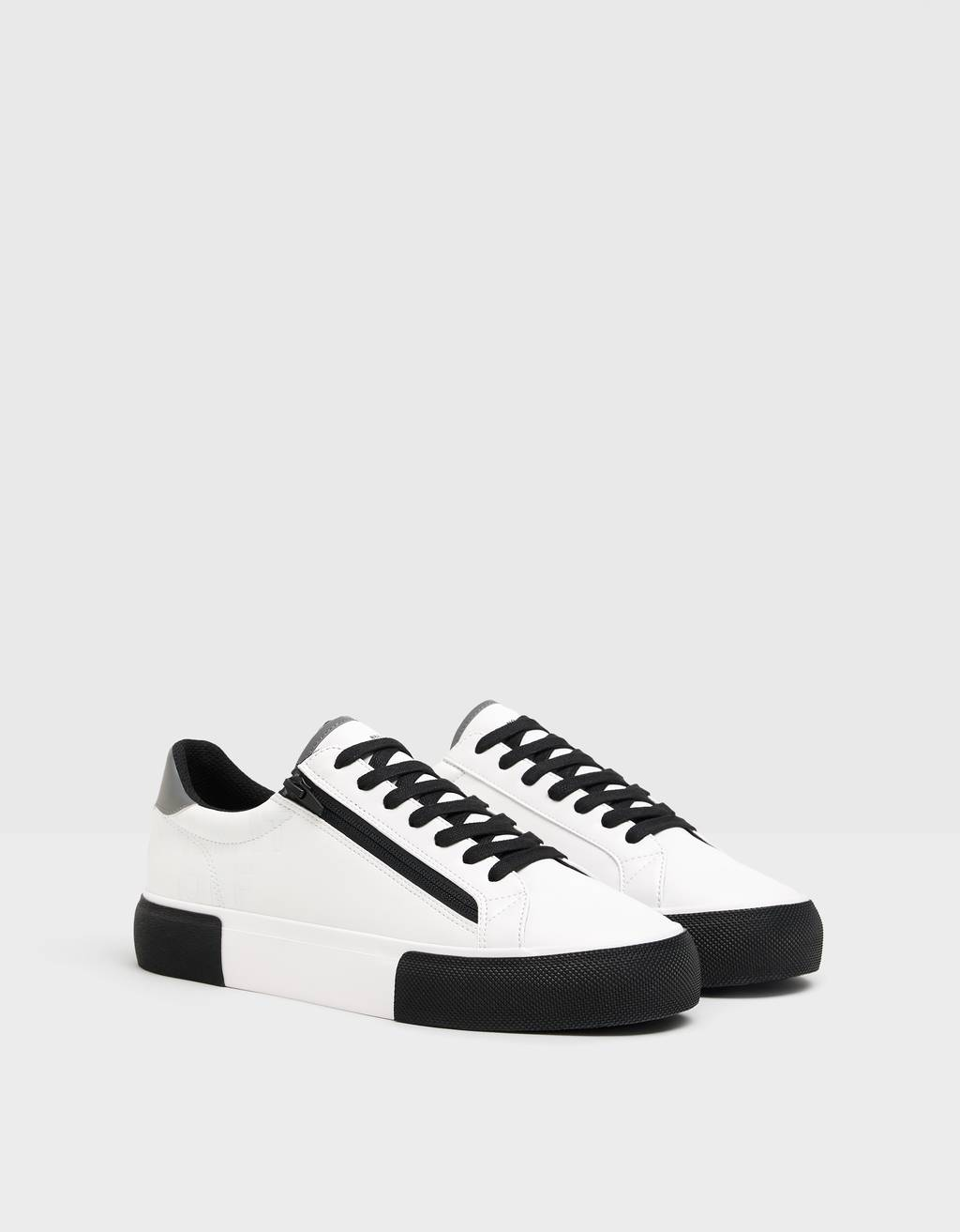 Men's contrast zip trainers.