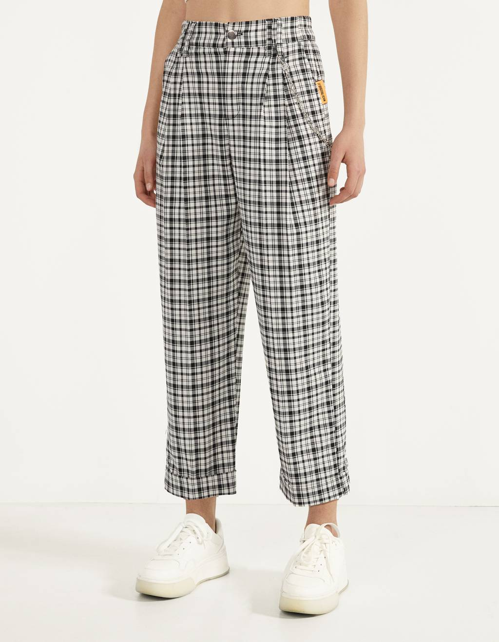 Checked trousers with chain detail