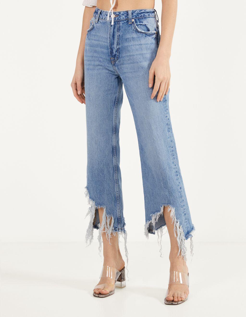 Kick flare jeans met gerafelde zoom