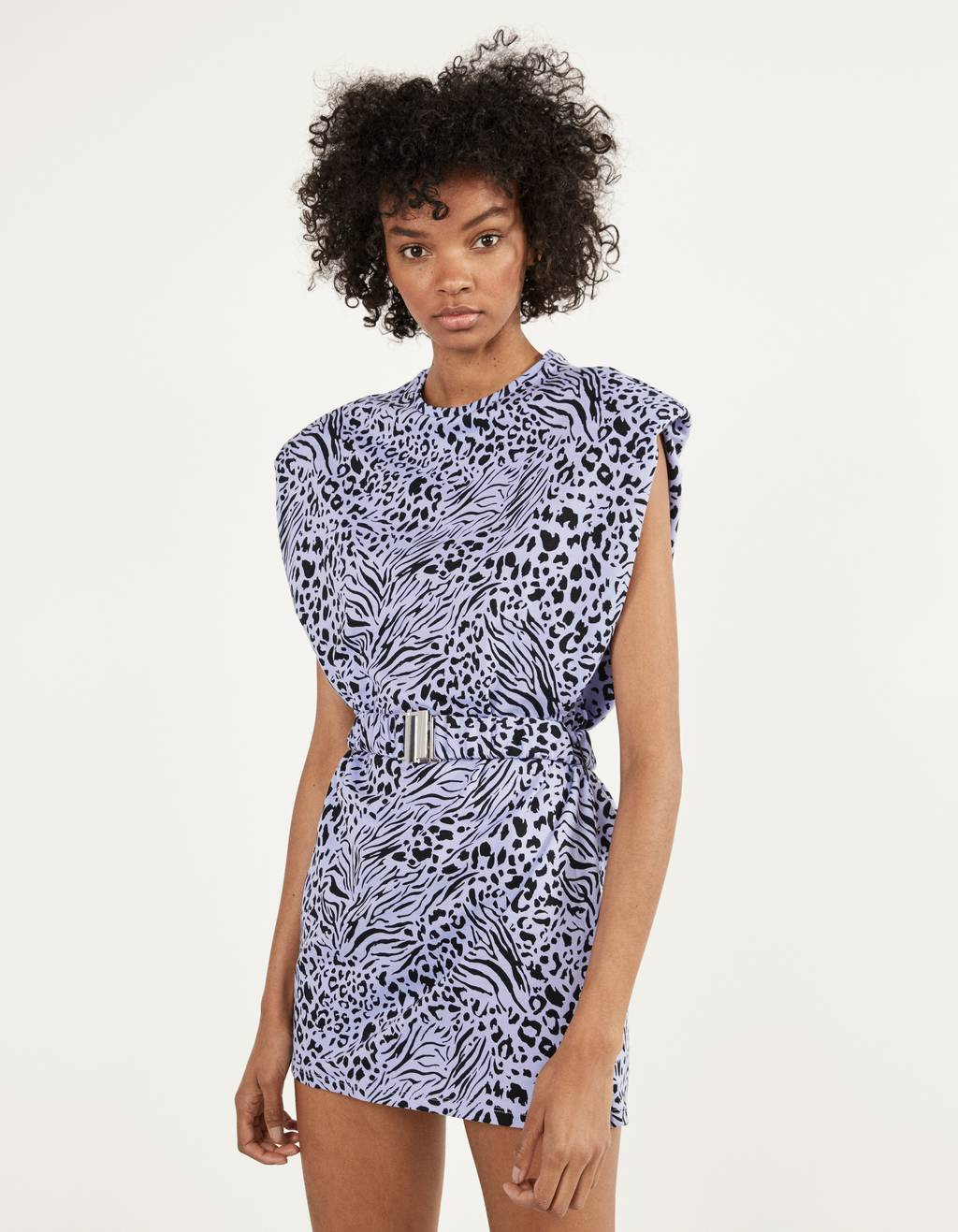 Dress with shoulder pads and a belt